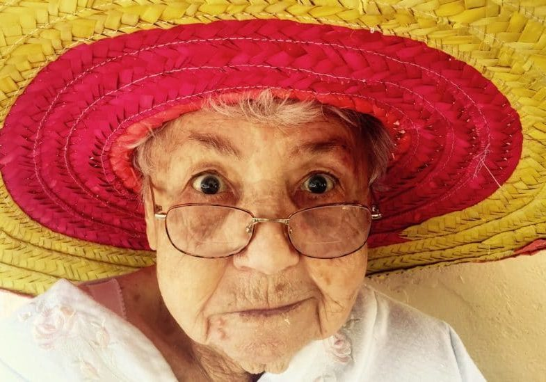 mortgage at 95 - elderly lady with a sun hat